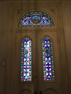 The half moon stained glass came from France and the other two panels were commissioned to match.